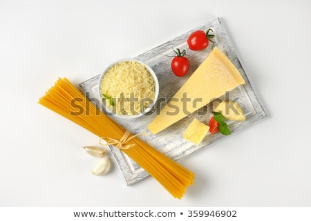 Stock photo: parmesan cheese and uncooked spaghetti