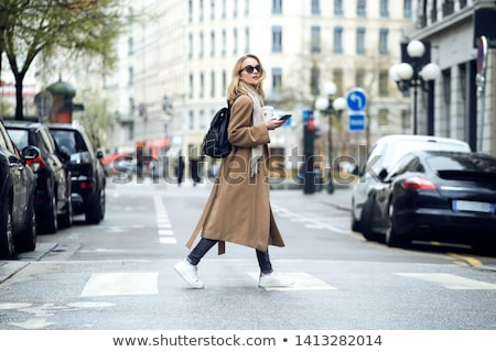 Walking with coffee. Stock photo © Fisher