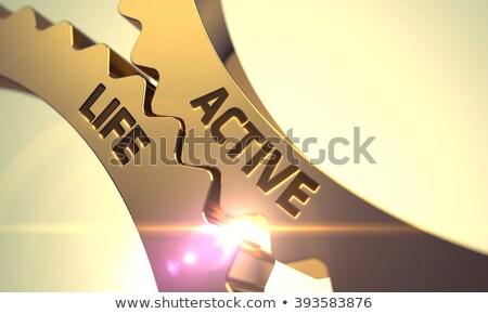 Active Life Concept. Golden Metallic Cog Gears. Stock photo © tashatuvango