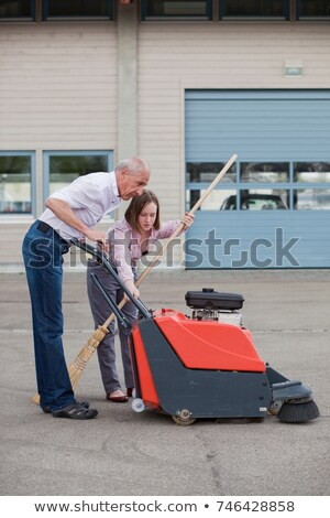 old man and young girl cleaning court stock photo © is2