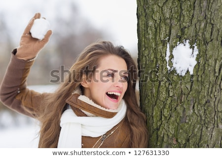 Young woman with snowball and snow Stock photo © IS2