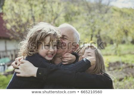 portré · mosolyog · nagymama · unokák · ölel · kanapé - stock fotó © is2