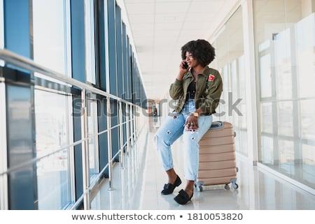 africano · mulher · mala · falante · telefone · empresária - foto stock © studioworkstock