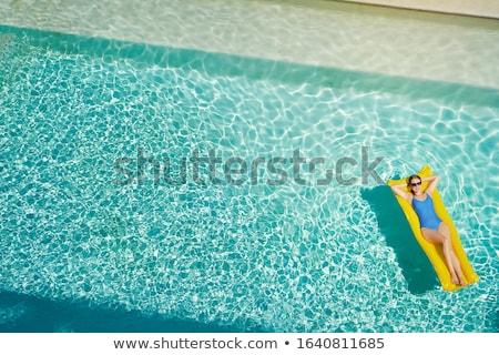 menina · inflável · colchão · piscina · jovem · sorridente - foto stock © is2