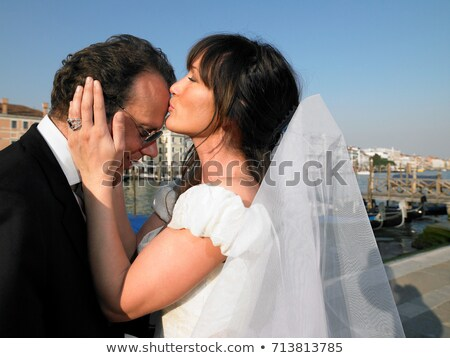 Bride kissing groom's forehead. Venice Stock photo © IS2