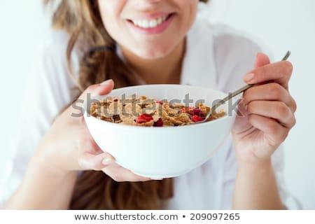 jedzenie · zboża · sexy · kobieta · posiedzenia · bed · zbóż - zdjęcia stock © stryjek