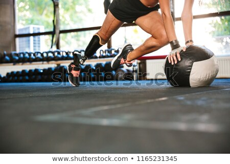 Portrait of gymnastic handicapped girl 20s with prosthesis in sp Stock photo © deandrobot