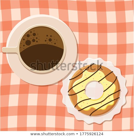 Black coffee cup with saucer and doughnut with black sandwich cookies on black stone kitchen table b Stock photo © DenisMArt