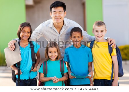 students outside school teacher standing together stock photo © lopolo