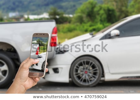 Male Driver take pictures of accident-damaged vehicle with a  ho Stock photo © snowing