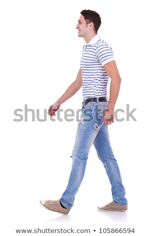young man in polo shirt walks and looks to side Stock photo © feedough