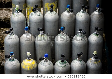Collection of grey scuba diving air oxygen tanks waiting Stock photo © galitskaya