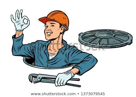 gesture ok okay plumber in the manhole stock photo © studiostoks