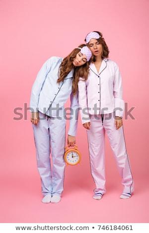 Two lovely girls wearing pajamas Stock photo © deandrobot