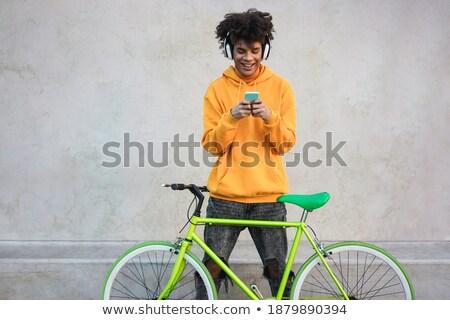 adolescente · mentiras · grama · fones · de · ouvido · moço · cara - foto stock © deandrobot