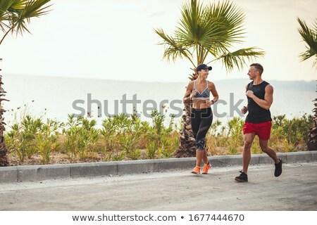 lopen · paar · jogging · strand · praten - stockfoto © dolgachov