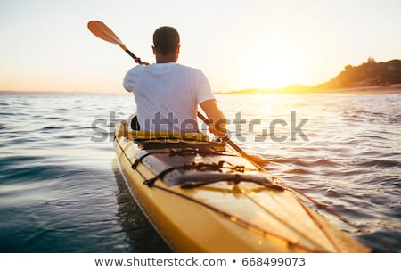 Man kajak zonsondergang illustratie sport zee Stockfoto © adrenalina