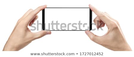 Two hands holding horizontal the black smartphone with blank scr Stock photo © Freedomz