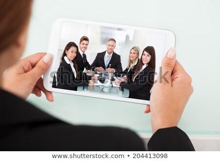 Eller işkadını izlerken semineri tablet iş Stok fotoğraf © dolgachov