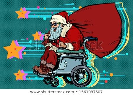 Papai noel ativo cadeira de rodas usuário inválido natal Foto stock © studiostoks