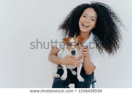 Portrait of joyful curly girl petting her dog, rejoicing buying jack russell terrier, smiles broadly Stock photo © vkstudio