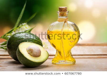 Bottle of avocado oil with fresh avocado Stock photo © Alex9500