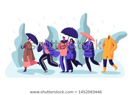 Vrouw lopen paraplu regen onweersbui jonge vrouw Stockfoto © robuart