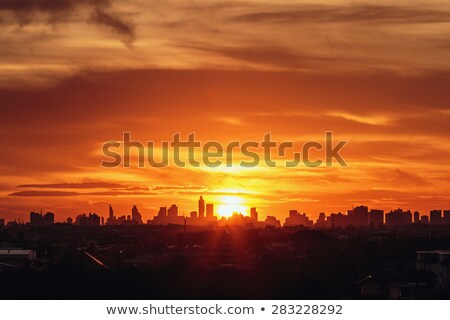 dramatic sunset with building silhouette stock photo © anna_om