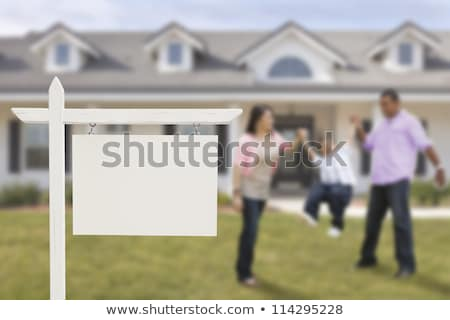Real Estate Sign with Smiling Hispanic Woman stock photo © feverpitch