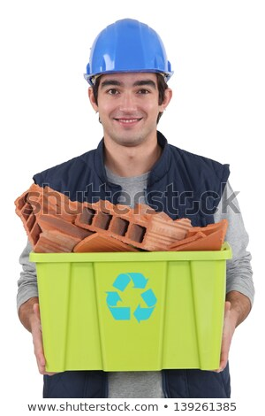 young bricklayer carrying recycling tub full of red bricks Stock photo © photography33