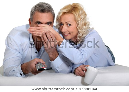 Woman covering her husband's eyes during a scary film Stock photo © photography33
