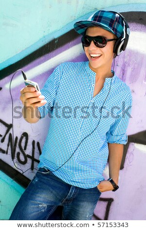Boy holding mp3 player Stock photo © lovleah
