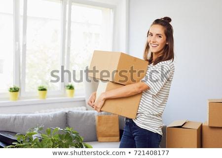 Woman moving belongings Stock photo © photography33