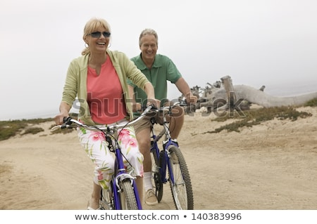 Middle-aged people on bike ride at the beach stock photo © photography33