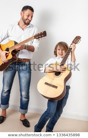Lad jouer instrument guitare signe portrait Photo stock © photography33