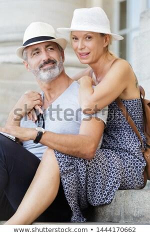 Senior man sitting on some old stone steps Stock photo © photography33