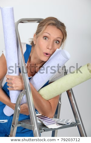 Woman with rolls of wallpaper and a stepladder Stock photo © photography33
