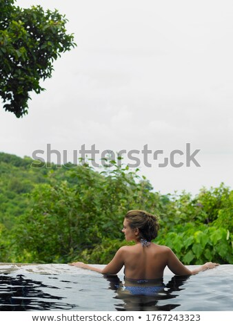gorgeous woman getting out of swimming pool stock photo © photography33