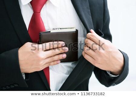 üzletember · dollár · zseb · menedzser · néz · komolyan - stock fotó © wavebreak_media