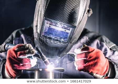 Industrial worker welding in factory Stock photo © mady70