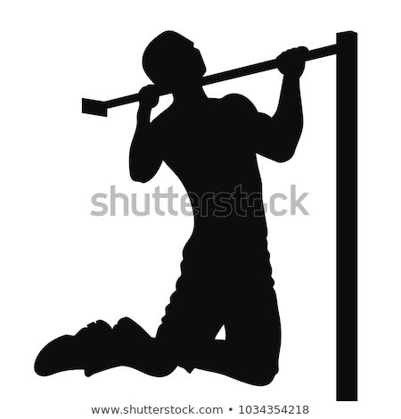 Strong man doing pull ups on a bar in a gym in the background.  Stock photo © dacasdo