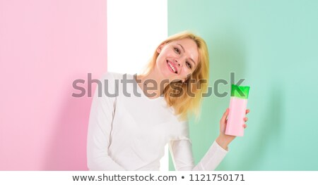 Smiling woman hold hairs preventing to fall Stock photo © vetdoctor