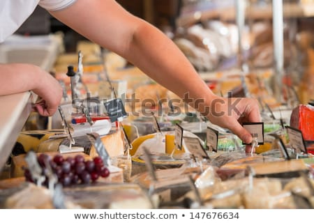 Grocery store. Cheese glass case closeup Stock photo © HASLOO