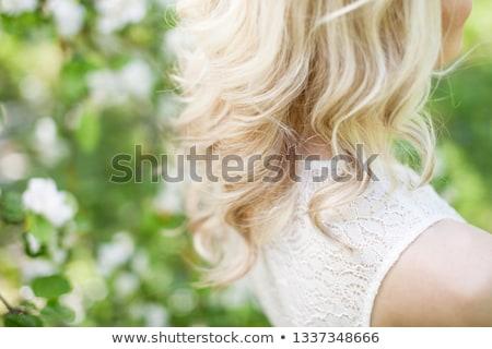 Blond girl in the long dress in the garden Stock photo © dashapetrenko