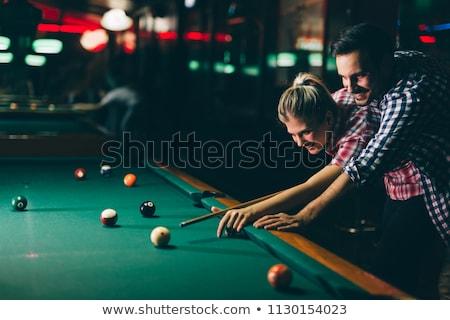 пару играет бильярд человека женщину бильярдных Сток-фото © Kzenon
