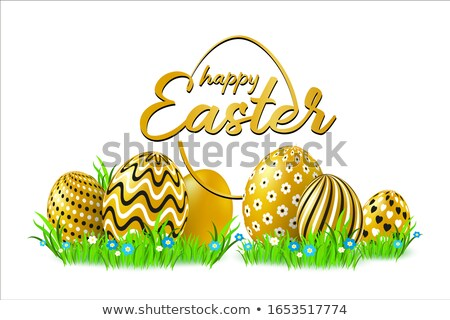 Golden easter eggs on the green grass Stock photo © icefront