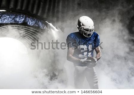 american football helmet in the colored smoke stock photo © cherezoff