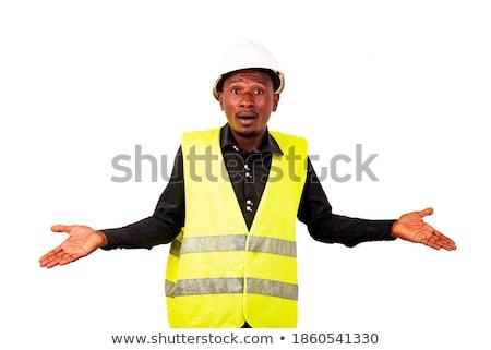 shocked businessman shrugging with raised hands stock photo © bmonteny