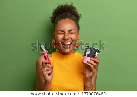 Gladness. Delightful Woman with Ice Cream Laughing Stock photo © gromovataya