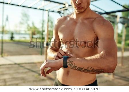 élégant Guy torse nu horloge temps Photo stock © mettus